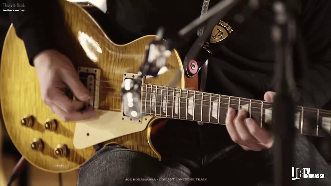 世界吉他手 世界吉他手 【Joe Bonamassa】在Joe 在成为新一代的蓝调摇滚领军大将之后,他不再局限自己的演奏领域,同样的曲子在演出或是重新录音他也会使用不一样的吉,Distant Lonesome Train 寂寞列车却是惊天动地!